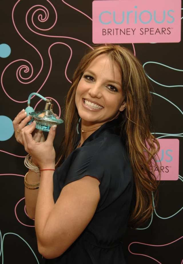 A younger Britney Spears with her perfume Curious.