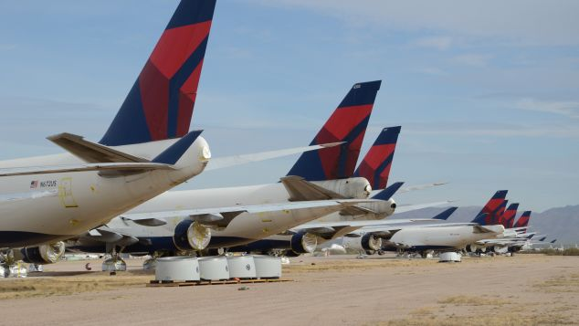 Delta Air Lines Boeing 747-400s sit in the desert awaiting their fate after being retired from the airline's fleet.