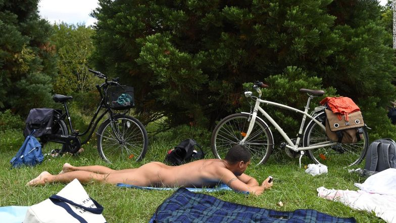 A naked man lies in the grass at a newly opened space for naturists at the Bois de Vincennes park in Paris on August 31, 2017. The space will be open daily until October 15th. / AFP PHOTO / Bertrand GUAY (Photo credit should read BERTRAND GUAY/AFP/Getty Images)