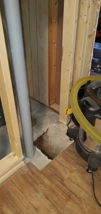 telepost in a basement being installed by Dynamic Foundation