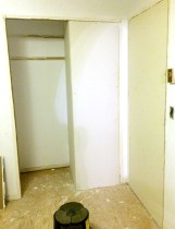 New closet sheet rocked in, old doorway on right.