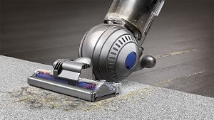 Close-up of Dyson DC66 Animal vacuum cleaner across carpet