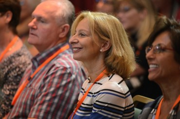 Happy audience listening to many presentations.