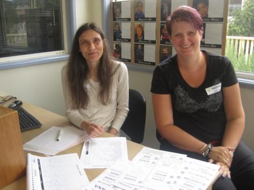 Hariklia Nguyen and Nadine Schnabel at the registration desk.