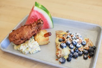 Weekend brunch at Portland's popup HunnyMilk features dishes like this fried chicken drumstick, toasty cornbread, fennel seed honey, egg salad, watermelon, left, and vanilla bean crepe with blueberries, lemon curd and honeycomb crunchies.