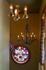 Rustic chandeliers and stained glass