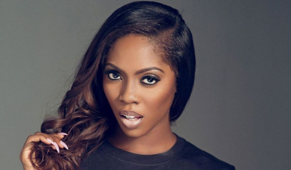 Tiwa Savage with extensions long hairstyle