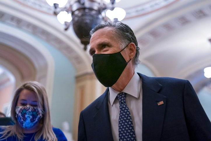 Sen. Mitt Romney, R-Utah, pauses to answer questions from reporters after the Senate voted to consider hearing from witnesses in the impeachment trial of former President Donald Trump, at the Capitol in Washington, Saturday, Feb. 13, 2021. (AP Photo/J. Scott Applewhite)