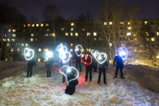People draw hearts with their cellphones flashlights in support of jailed opposition leader Alexei Navalny and his wife Yulia Navalnaya Moscow, Russia, Sunday, Feb. 14, 2021. When the team of jailed Russia opposition leader Alexei Navalny announced a protest in a new format, urging people to come out to their residential courtyards on Sunday and shine their cellphone flashlights, many responded with jokes and skepticism. After two weekends of nationwide demonstrations, the new protest format looked to some like a retreat. But not to Russian authorities, who moved vigorously to extinguish the illuminated protests planned for Sunday. (AP Photo/Pavel Golovkin)