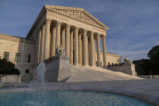 FILE - In this Nov. 5, 2020 file photo, the Supreme Court is seen in Washington. The Supreme Court will take up challenges to controversial Trump administration policies affecting family-planning clinics and immigrants, even though the Biden administration has announced it is reviewing them. (AP Photo/J. Scott Applewhite)