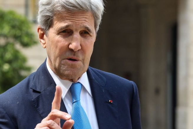 """US former Secretary of State and member of the Carnegie foundation John Kerry gestures as speaks to the press while leaving the Elysee Palace in Paris, on May 23, 2018 after the """"Tech for Good"""" summit. (Photo by ludovic MARIN / AFP) (Photo by LUDOVIC MARIN/AFP via Getty Images)"""