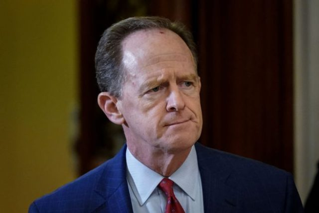 WASHINGTON, DC - JANUARY 30: Sen. Pat Toomey (R-PA) leaves the Senate chamber during a recess in the Senate impeachment trial of U.S. President Donald Trump continues at the U.S. Capitol on January 30, 2020 in Washington, DC. On Thursday, Senators continue asking questions for the House impeachment managers and the president's defense team. (Photo by Drew Angerer/Getty Images)