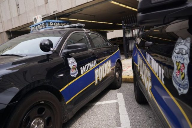 Police cars are seen outside of the Baltimore City Police Headquarters in Baltimore on August 8, 2017. Baltimore, a city of 2.8 million, is troubled by drug use, poverty and racial segregation problems. In 2016 violent crime in Baltimore was up 22 percent and murders up 78 percent, according to Attorney General Jeff Sessions. / AFP PHOTO / MANDEL NGAN (Photo credit should read MANDEL NGAN/AFP via Getty Images)