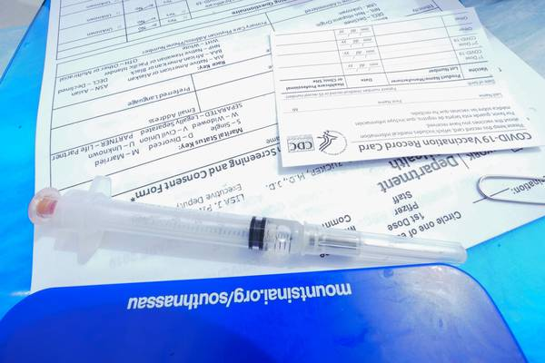 A syringe filled with the Johnson & Johnson's one-dose COVID-19 vaccine is seen net to a vaccination card at the Vaxmobile, at the Uniondale Hempstead Senior Center, Wednesday, March 31, 2021, in Uniondale, N.Y. The Vaxmobile, is a COVID-19 mobile vaccination unit, sponsored by a partnership between Mount Sinai South Nassau and Town of Hempstead to bring the one-dose vaccine directly to hard-hit communities in the area. (AP Photo/Mary Altaffer)