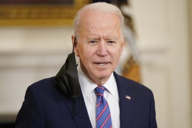 President Joe Biden responds to a question after speaking about the March jobs report in the State Dining Room of the White House, Friday, April 2, 2021, in Washington. (AP Photo/Andrew Harnik)