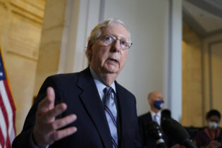 Senate Minority Leader Mitch McConnell, R-Ky., talks about the push by some Democrats to try to add seats to the Supreme Court, after a GOP policy luncheon, on Capitol Hill in Washington, Tuesday, April 20, 2021. (AP Photo/J. Scott Applewhite)