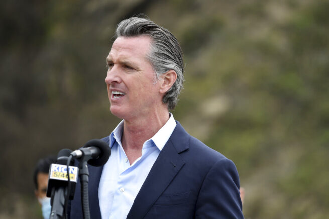 California Gov. Gavin Newsom speaks during a press conference about the newly reopened Highway 1 at Rat Creek near Big Sur, Calif., Friday, April 23, 2021. Heavy rainstorms in January 2021 caused a landslide, which closed the scenic highway. (AP Photo/Nic Coury)