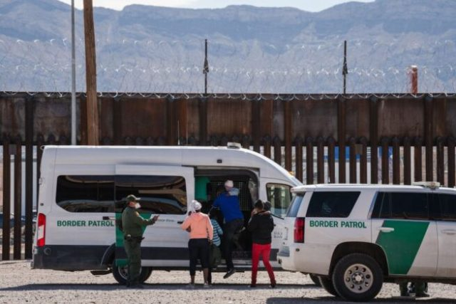 """Border Patrol agents apprehend a group of migrants near downtown El Paso, Texas following the congressional border delegation visit on March 15, 2021. - President Joe Biden faced mounting pressure Monday from Republicans over his handling of a surge in migrants -- including thousands of unaccompanied children -- arriving at the US-Mexican border. Republican Congressman Kevin McCarthy of California, who leads his party in the House of Representatives, told reporters last week the """"crisis at the border is spiraling out of control.""""""""It's entirely caused by the actions of this administration,"""" said McCarthy. (Photo by Justin Hamel / AFP) (Photo by JUSTIN HAMEL/AFP via Getty Images)"""