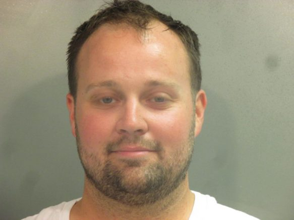"""FAYETTEVILLE, AR - APRIL 29: In this handout photo provided by the Washington County Sheriff's Office, former television personality on """"19 Kids And Counting"""" Josh Duggar poses for a booking photo after his arrest April 29, 2021 in Fayetteville, Arkansas. Duggar was reportedly arrested by federal agents and is being detained on a federal hold. (Photo by Washington County Sheriff's Office via Getty Images)"""