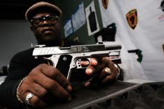 JERSEY CITY - MARCH 25: Lateif Dickerson displays one of his prized pistols at his gun instruction headquarters on March 25, 2021 in Jersey City, New Jersey. Dickerson, a weapons specialist who teaches marksmanship and gun handling, is a firm believer in the Second Amendment and the right to own firearms. In the wake of recent mass shootings, the Biden administration is pushing for the Senate to pass gun legislation already passed by the House. Area gun businesses have seen a rise in sales recently that has even led to a shortage of bullets. (Photo by Spencer Platt/Getty Images)