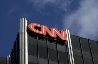 The Cable News Network (CNN) logo adorns the top of CNN's offices on the Sunset Strip, January 24, 2000 in Hollywood, CA. CNN was hit with job cuts earlier this week after CNN's parent company, Time-Warner, Inc., completed its merger with America Online, Inc. (Photo by David McNew/Newsmakers)