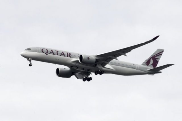 FILE - In this Nov. 7, 2019 file photo, a Qatar Airways jet approaches Philadelphia International Airport in Philadelphia. Long-haul carrier Qatar Airways on Sunday, Sept. 27, 2020, reported revenue losses of $1.9 billion for the past year, blaming the coronavirus pandemic, its liquidation of shares in Air Italy and the ongoing boycott of Doha by four Arab nations for the drop. (AP Photo/Matt Rourke, File)