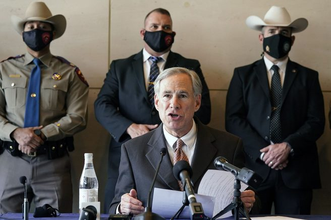 A masked Texas Gov Greg Abbott speaks at a news conferenced about migrant children detentions Wednesday, March 17, 2021, in Dallas. (AP Photo/LM Otero)