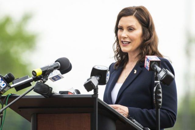 Mich. Gov. Gretchen Whitmer speaks at a Dow Diamond press event, providing an update on the state's COVID-19 response. (Kaytie Boomer/The Bay City Times via AP)