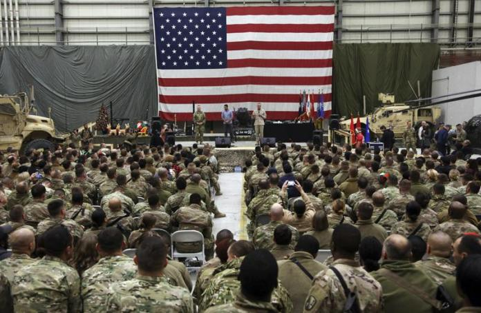Gen. Joseph Dunford speaks during a ceremony on Christmas Eve at a U.S. airfield in Bagram, north of Kabul, Afghanistan. (AP Photo/Rahmat Gul, File)
