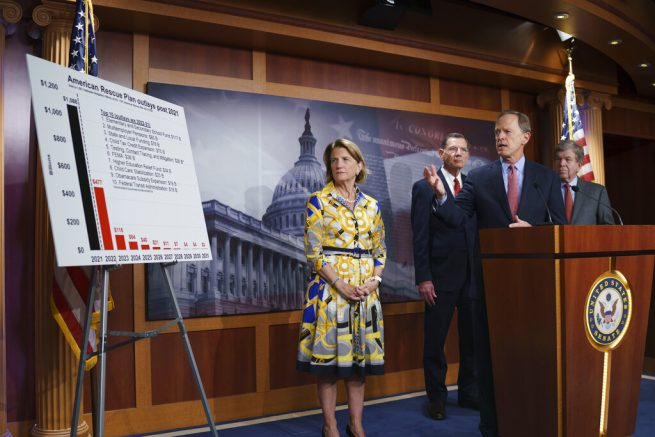 In this photo taken Thursday, May 27, 2021, Sen. Shelley Moore Capito, R-W.Va., the GOP's lead negotiator on a counteroffer to President Joe Biden's infrastructure plan, listens at left as she is joined at a news conference by, from left, Sen. John Barrasso, R-Wyo., Sen. Pat Toomey, R-Pa., chairman of the Senate Republican Conference, and Sen. Roy Blunt, R-Mo., at the Capitol in Washington. Biden and the West Virginia senator will meet Wednesday afternoon to work on their differences. (AP Photo/J. Scott Applewhite)