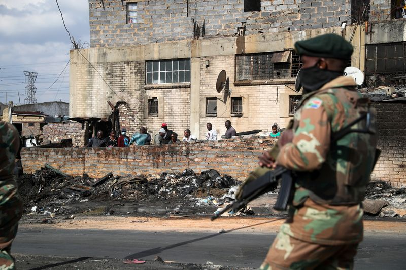 FILE PHOTO: Members of the military patrol through the streets of Alexandra township as the country deploys the army to quell unrest linked to the jailing of former President Jacob Zuma, in Johannesburg