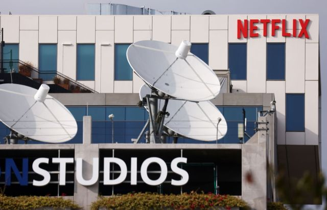 LOS ANGELES, CALIFORNIA - OCTOBER 07: The Netflix logo is displayed at Netflix's Los Angeles headquarters (TOP) on October 07, 2021 in Los Angeles, California. The IATSE union which represents Hollywood's film and television production crews voted to authorize a strike, calling for better working conditions and higher pay amid a surge in streaming demand. Negotiations are ongoing but a strike may be imminent. (Photo by Mario Tama/Getty Images)