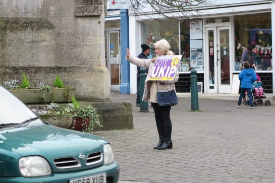 with hand back, boots and banner for Ukip in Sleaford. (c) 2016 Daniel Zylbersztajn, All Rights reserved