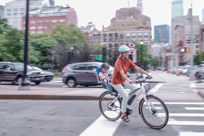 Priority Embark, woman riding