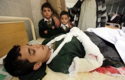 Image #: 33808798 epa04530857 A school boy who was injured in a Taliban attack receives medical treatment at a hospital in Peshawar, Pakistan, 16 December 2014. Pakistani commandos are fighting Taliban militants who have killed at least 23 people and taken hundreds of students and teachers hostage at a military-run school, officials said. 'The operation is under way' in the north-western city of Peshawar, said Pervaiz Khattak, chief minister of Khyber-Pakhtunkhwa province. 'Intense gun fighting is taking place inside the school.' The area was cordoned off and helicopters were flying overhead. Those killed included 19 teenage students, Khattak said. The death toll may go up as militants have shot many other students in an auditorium at a school, a military statement said. EPA/ARSHAD ARBAB /LANDOV