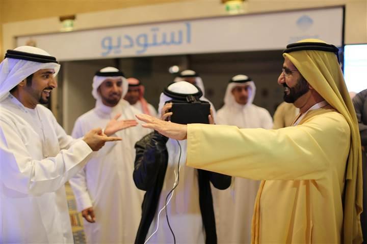 UAE Prime Minister and Ruler of Dubai Sheikh Mohammed bin Rashid al-Maktoum, right, and his son, Dubai's Crown Prince Sheikh Hamdan bin Mohammed al-Maktoum, left, test an unmanned aerial drone during Virtual Future Exhibition