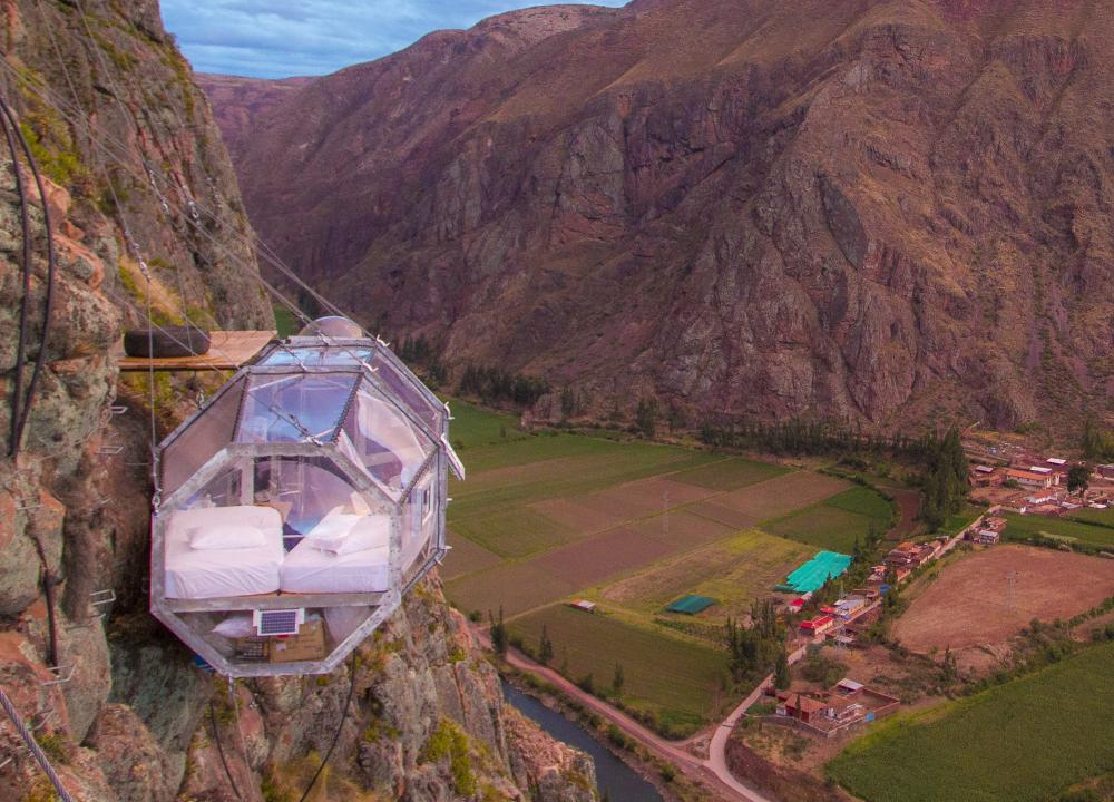 a hotel room pod attached to the side of a mountain at the Skylodge Adventure Park in Peru