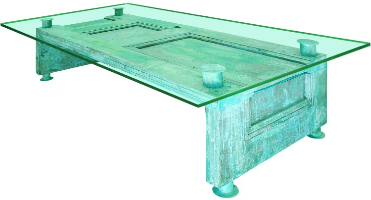 A glass coffee table with an old door as the table base