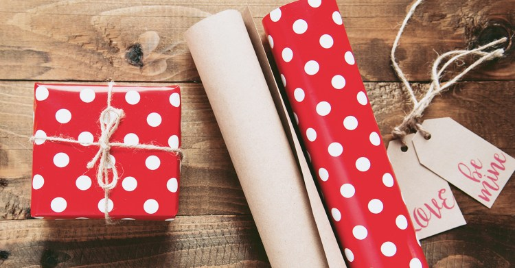 a gift, wrapping paper and gift tags