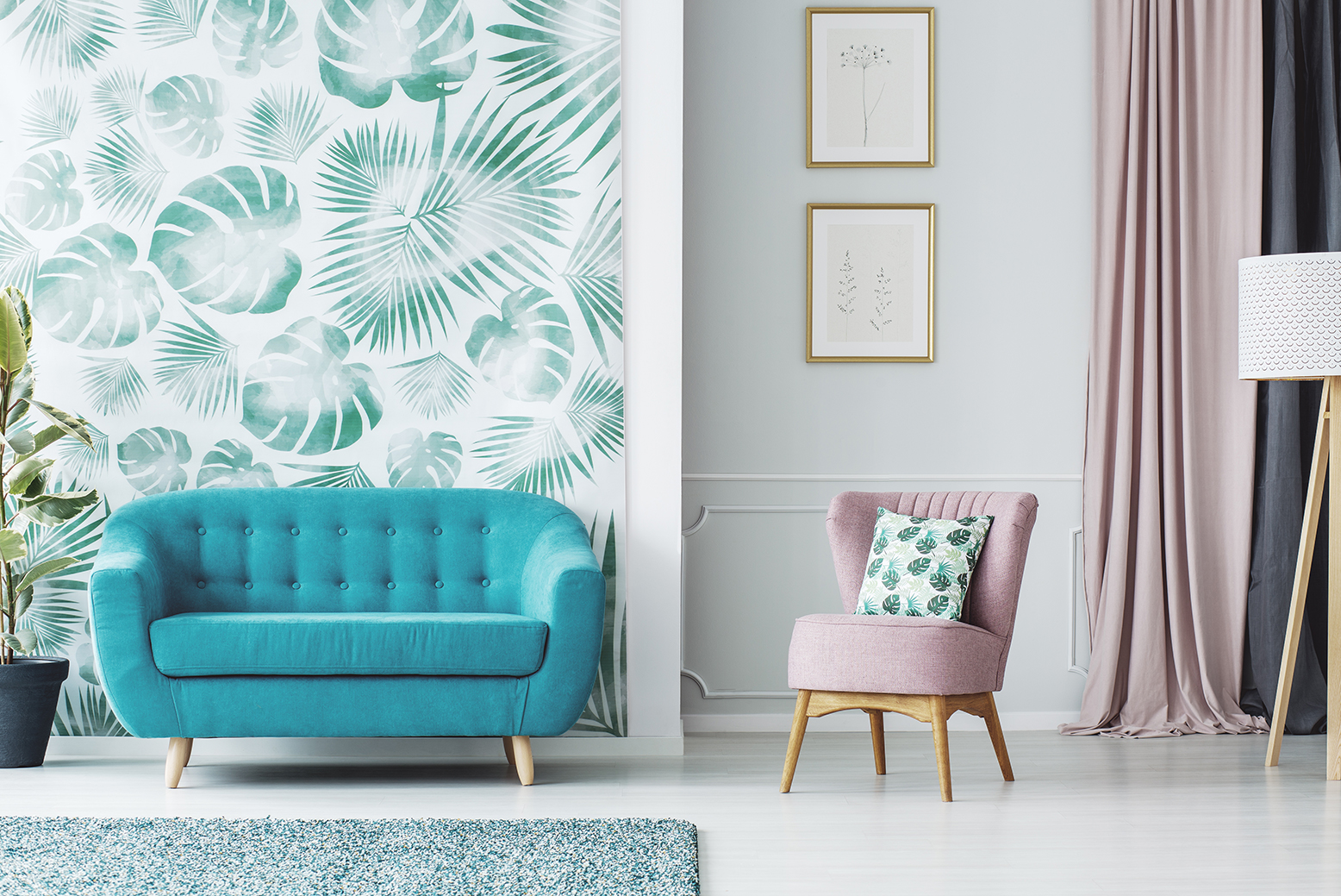 a living room with a tropical leaf wallpaper