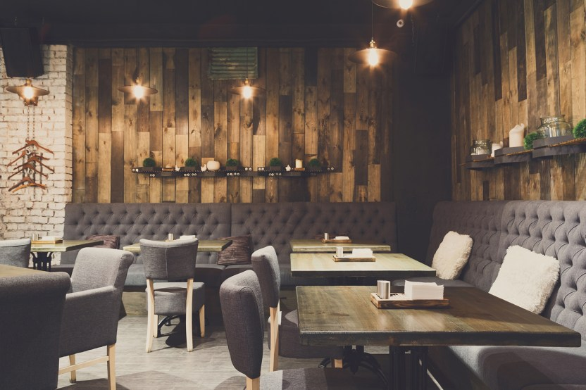 a rustic wooden-panel feature wall in a restaurant