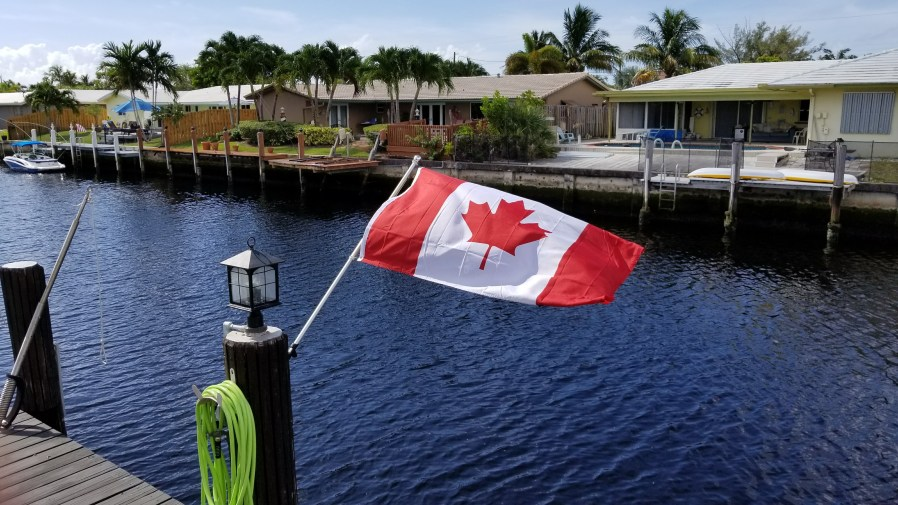 houses on a dock with a Canadian flag
