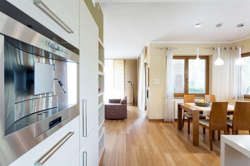 a kitchen with wooden floors