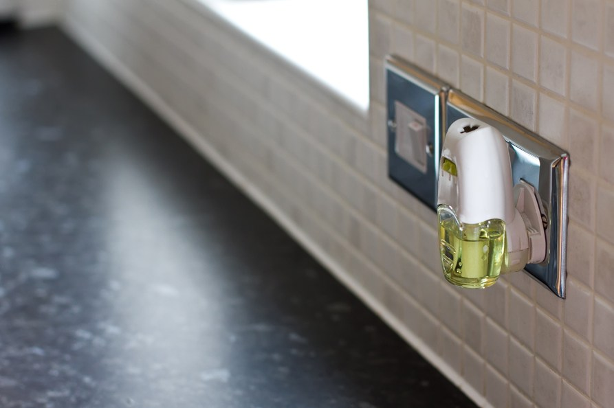 an air freshener plugged into a kitchen wall