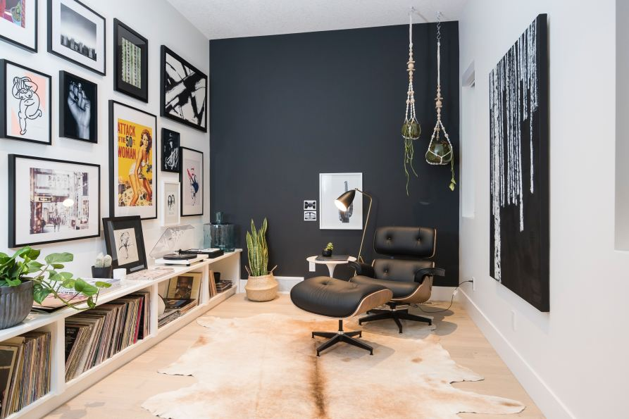 a room with paintings and vinyl records