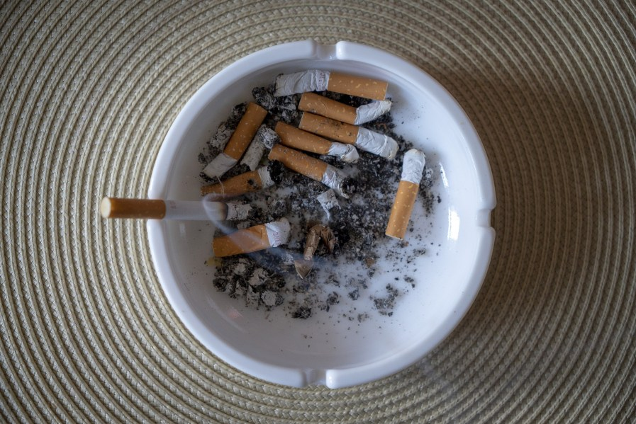an ashtray with cigarettes in it