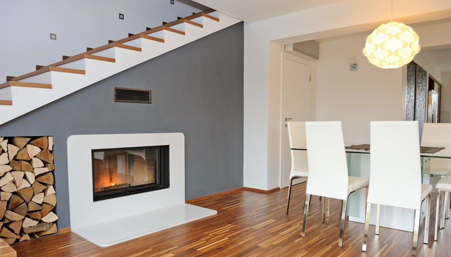 Staircase with a wood fireplace underneath