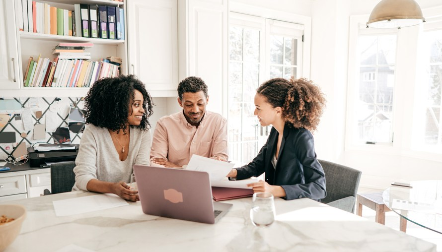 Couple consulting with a mortgage broker
