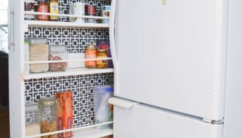 sliding cupboard shelf beside a fridge