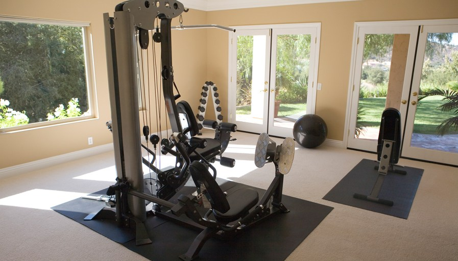 At-home gym with lots of windows and doors